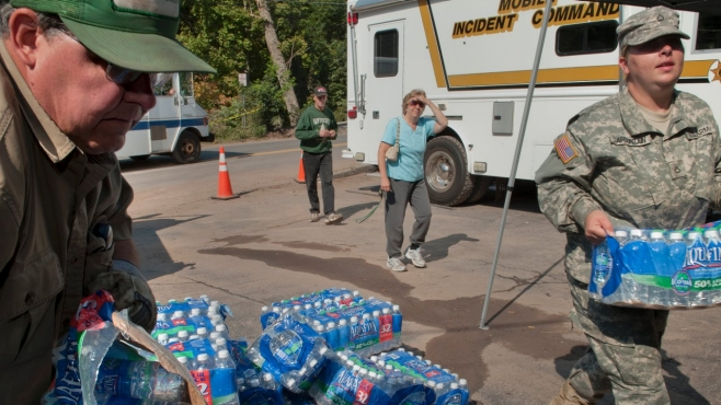 Volunteers bring relief supplies after an unexpected flood.