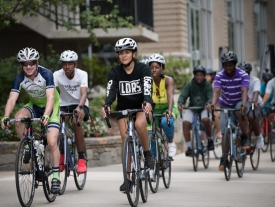 Bicyclists ride through town.