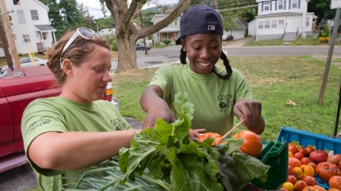 Students sell produce from their community garden.