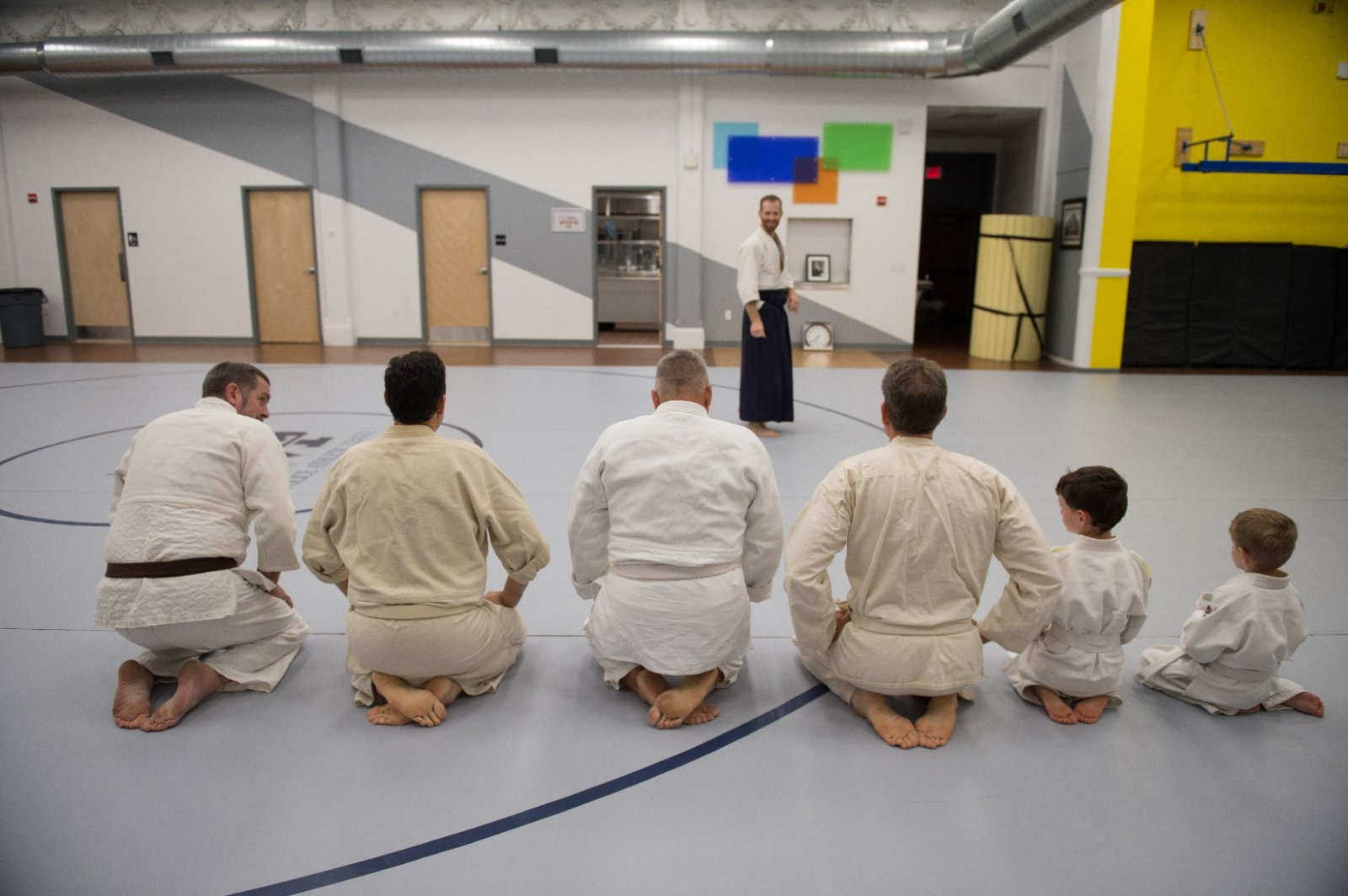 Students participate in a martial arts class at their local community center.