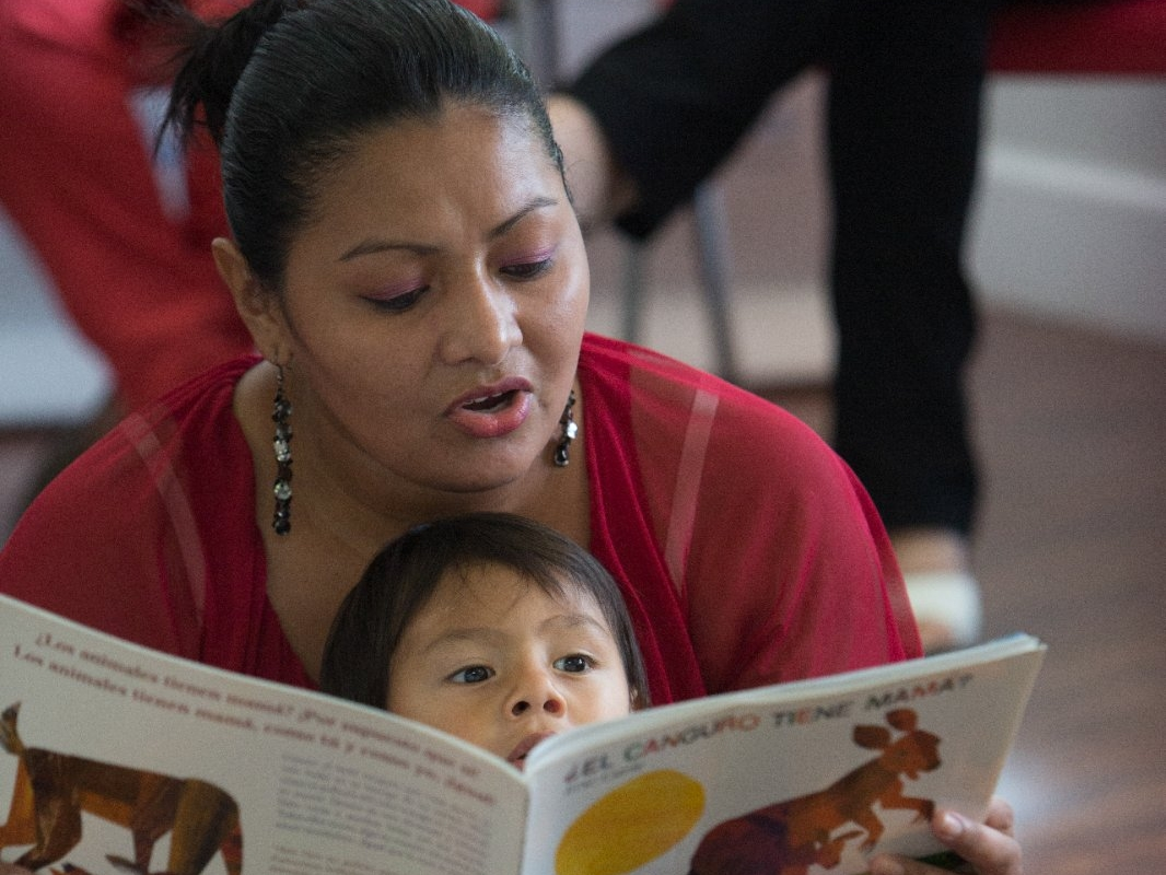 A woman reads to her son.