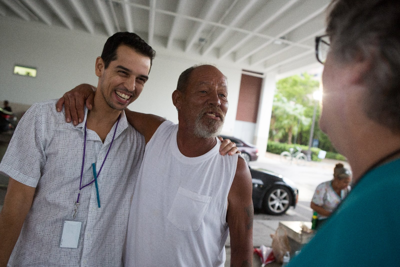 A coordinator for a program supporting the homeless stands with a resident.
