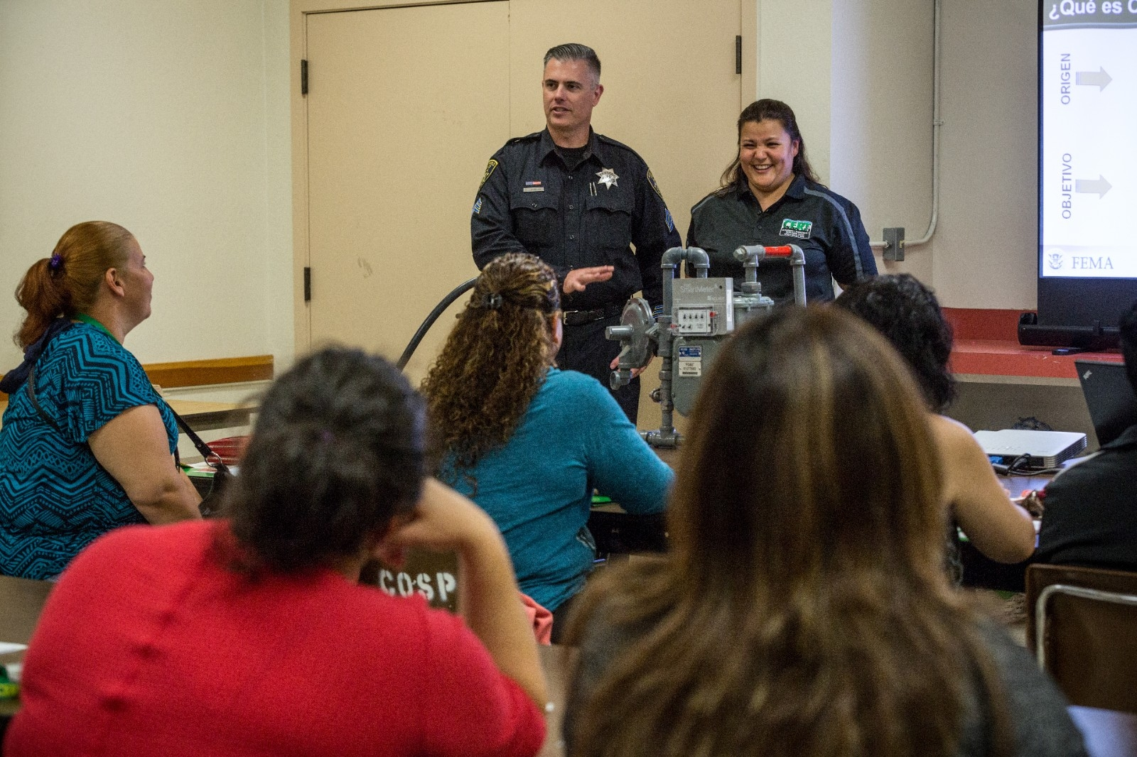 A police officer teaches a community class.