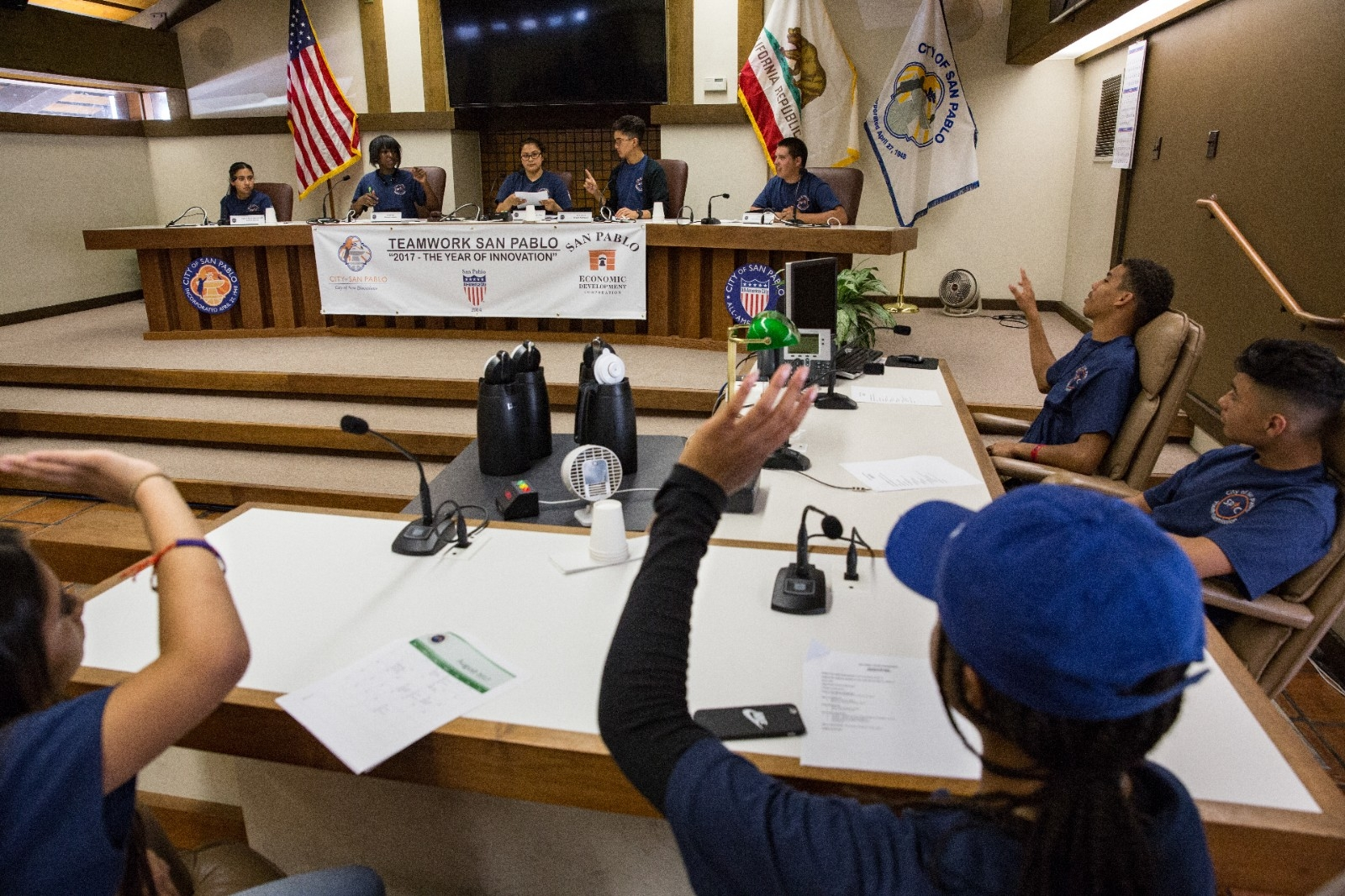 Students participate in youth commission meeting.