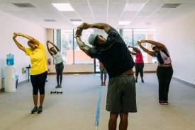 A man leads an exercise class.