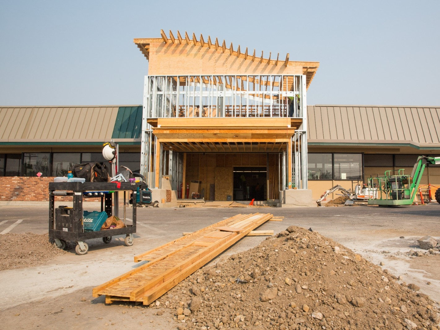Construction takes place at a strip mall.