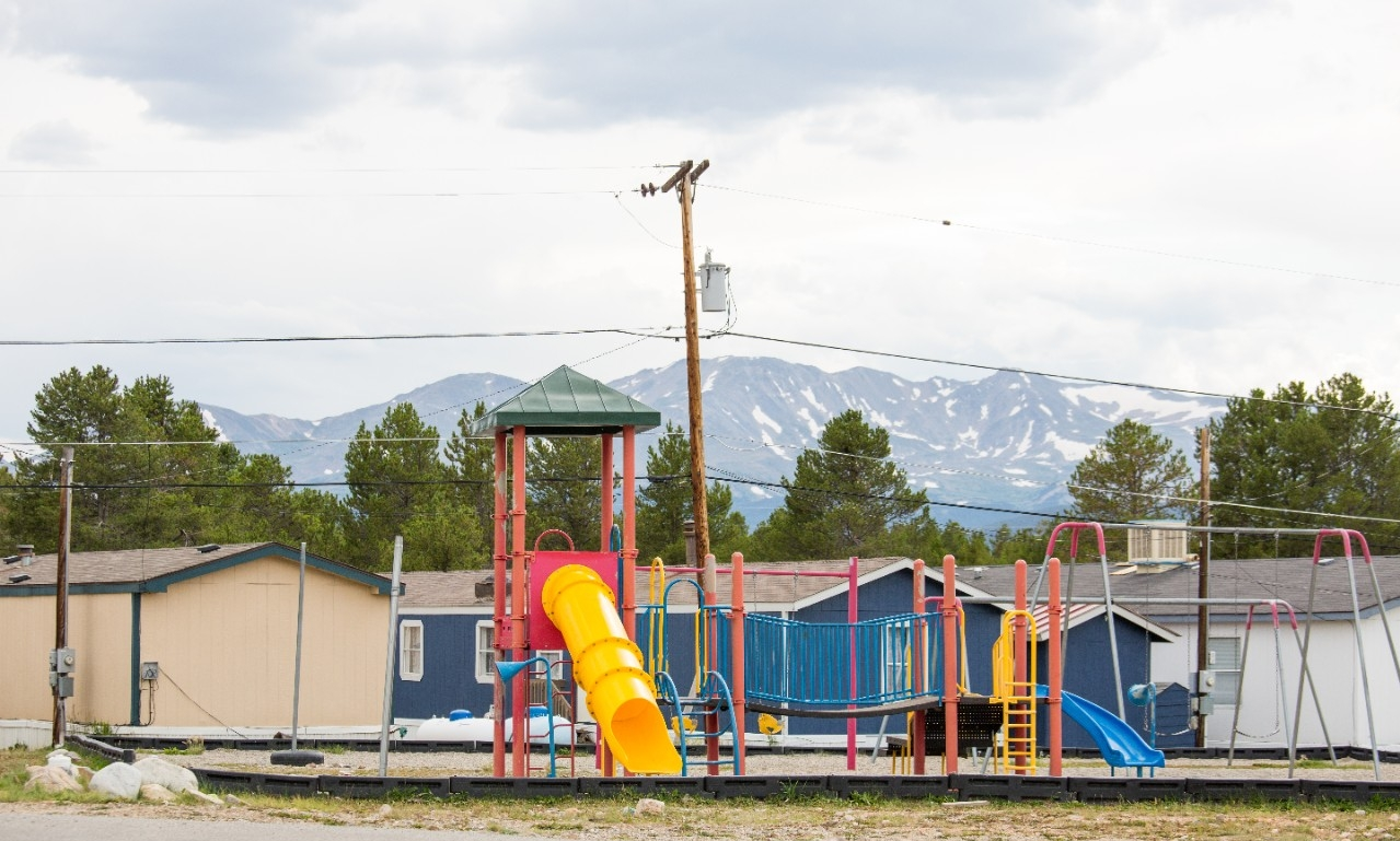A playground with mountains in the background.