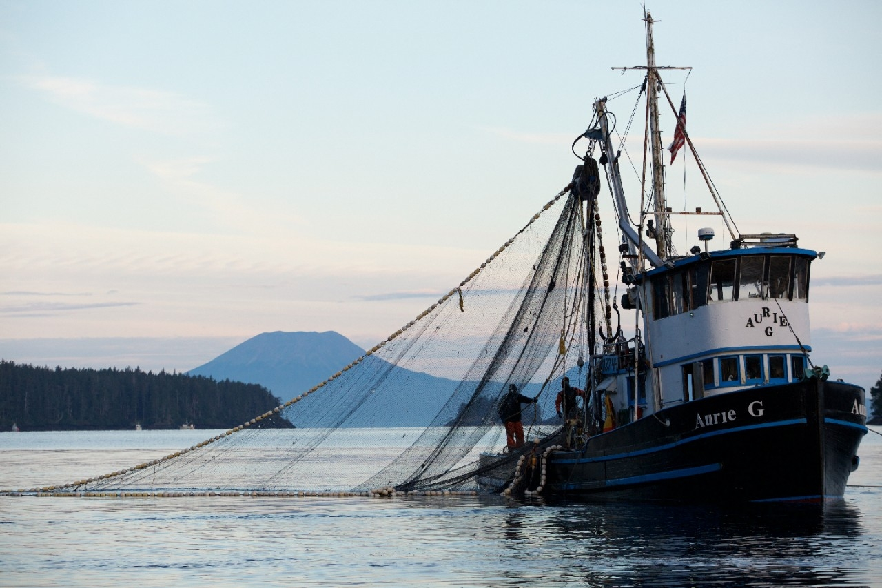 Fishermen working on a commercial fishing boat.
