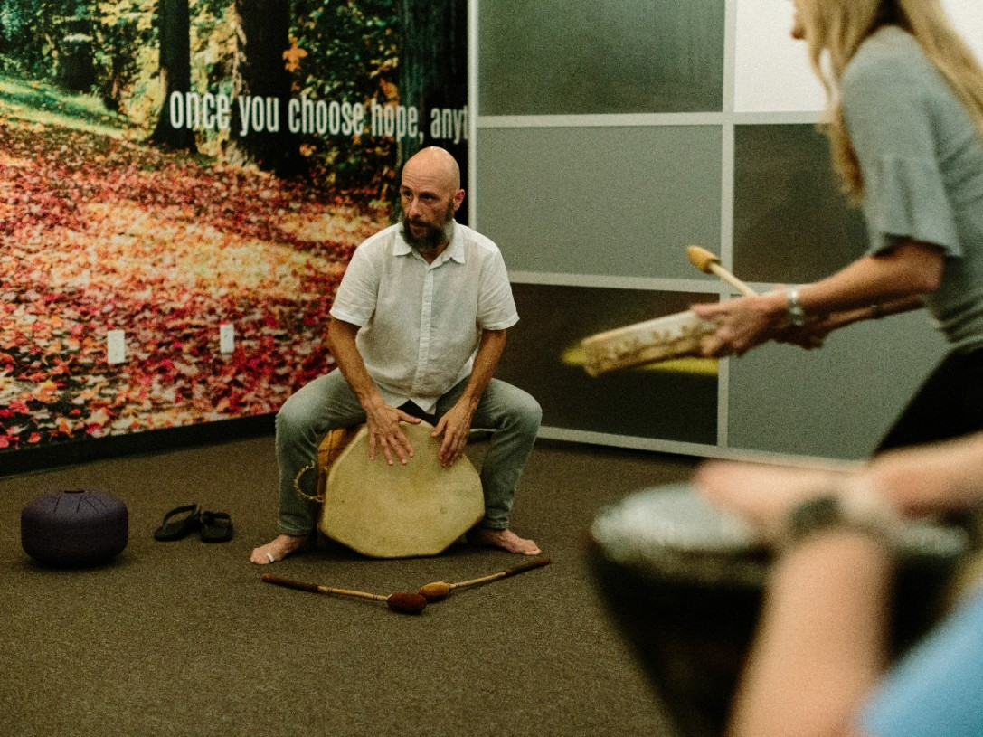 People attend a drumming circle.