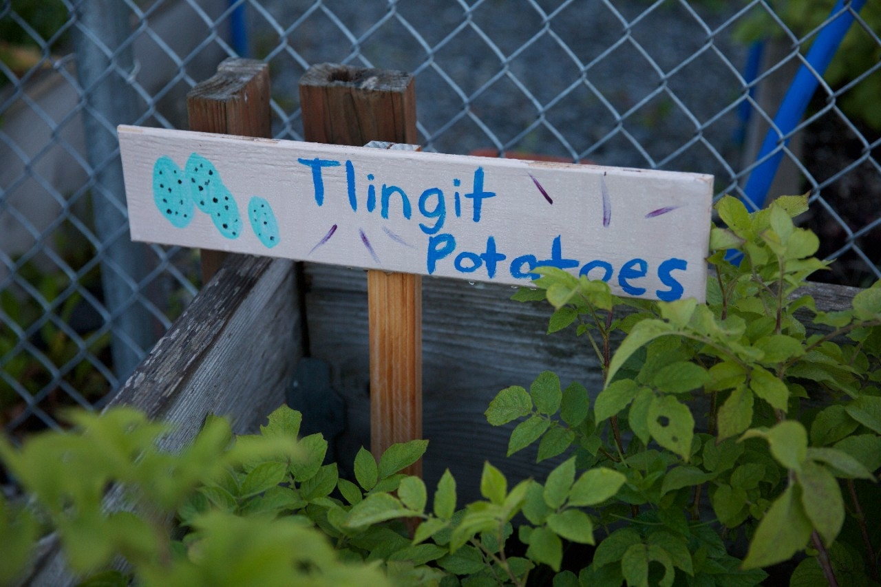 A sign in a community garden.