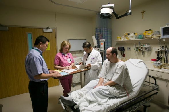 Hospital medical professionals check a patient during admittance procedure.