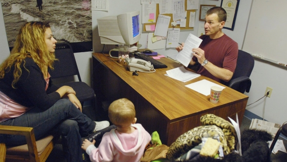 A counselor meets with a substance abuse patient and her baby daughter.