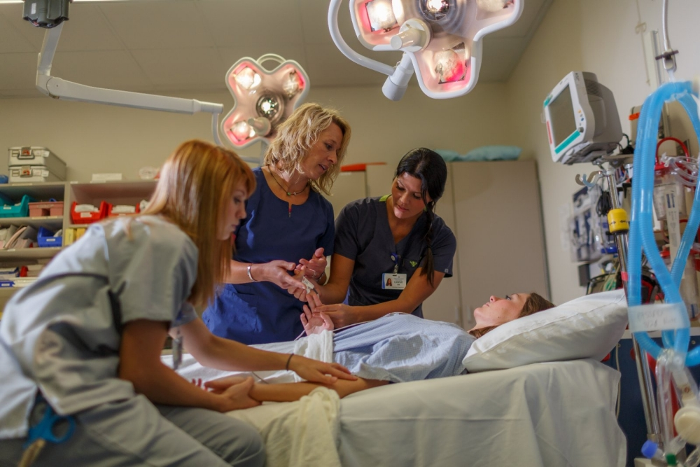 Nurses assist a patient in the hospital.