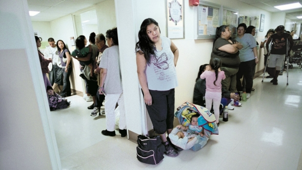 A line of waiting patients in a clinic.