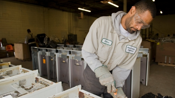 Man working in a recycling facility.