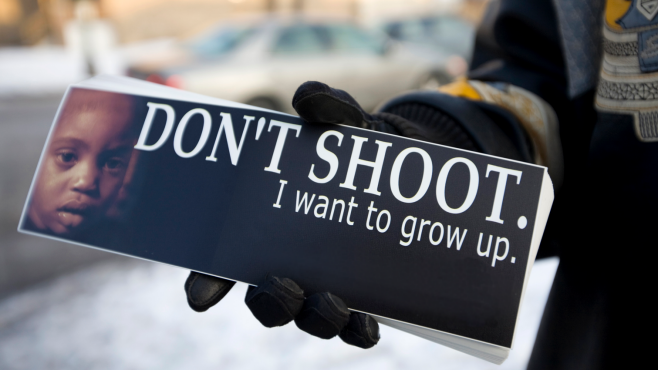 A Cease Fire volunteer in Chicago hands out bumper stickers that read,