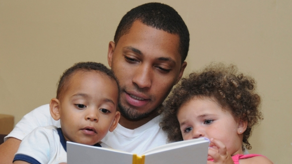 Father reading to children.