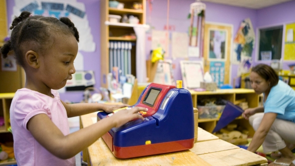 Young girl plays at a daycare center.